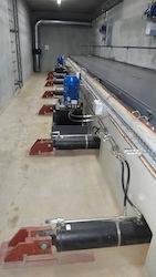 Le local des extracteurs hydrauliques de silo, photo Schmid