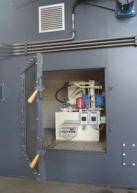 L'hydraulique des grilles est protégée dans un compartiment de la chaudière, photo Frédéric Douard