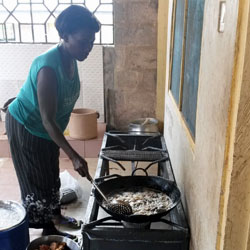 Women cooking on LPG stove in Ghana