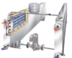 deux échangeurs de chaleur boues/boues reliés à un circuit d'eau fermé