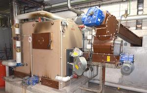 La chaudière a plaquettes Veto de 250 kW chauffe les ateliers et les bureaux depuis 2007, photo Frédéric Douard