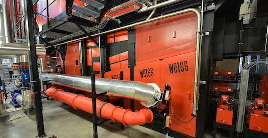 Les dispositifs d'alimentation en air primaire et en recyclage de fumée sous la grille de la nouvelle chaudière WEISS de Vénissieux, photo Frédéric Douard
